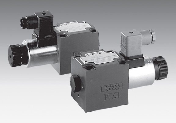 Directional poppet valves with solenoid operation